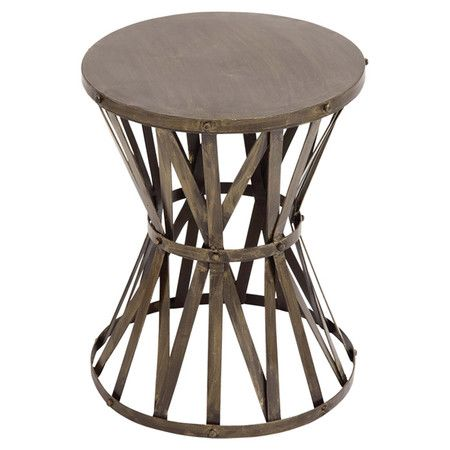 Add a rustic touch to your living room or den with this eye-catching accent stool, showcasing an openwork metal frame and brown finish.