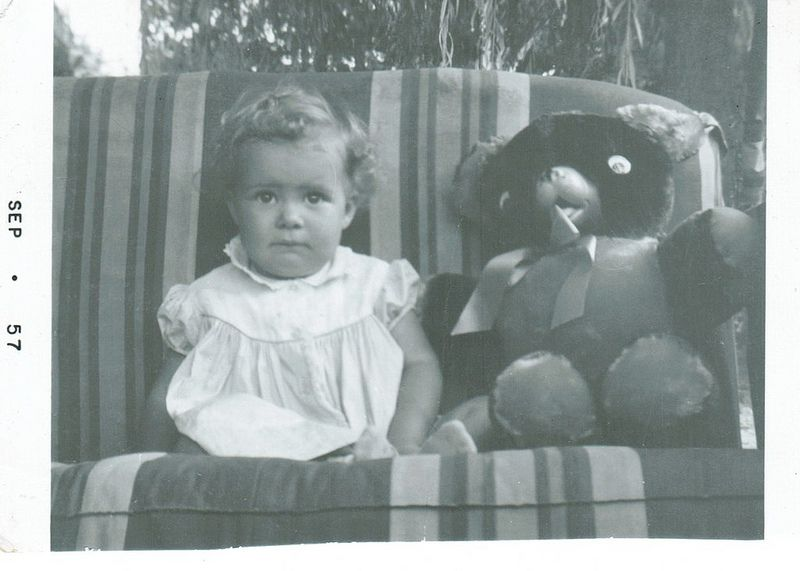 Little girl with a bear