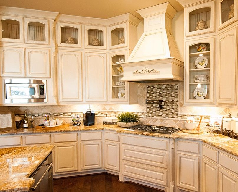 Texas livin' - Antique white kitchen cabinets! Love that the ...