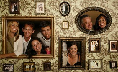 I love this as an alternative to a photo booth... use old family wedding photos for the surrounding pics