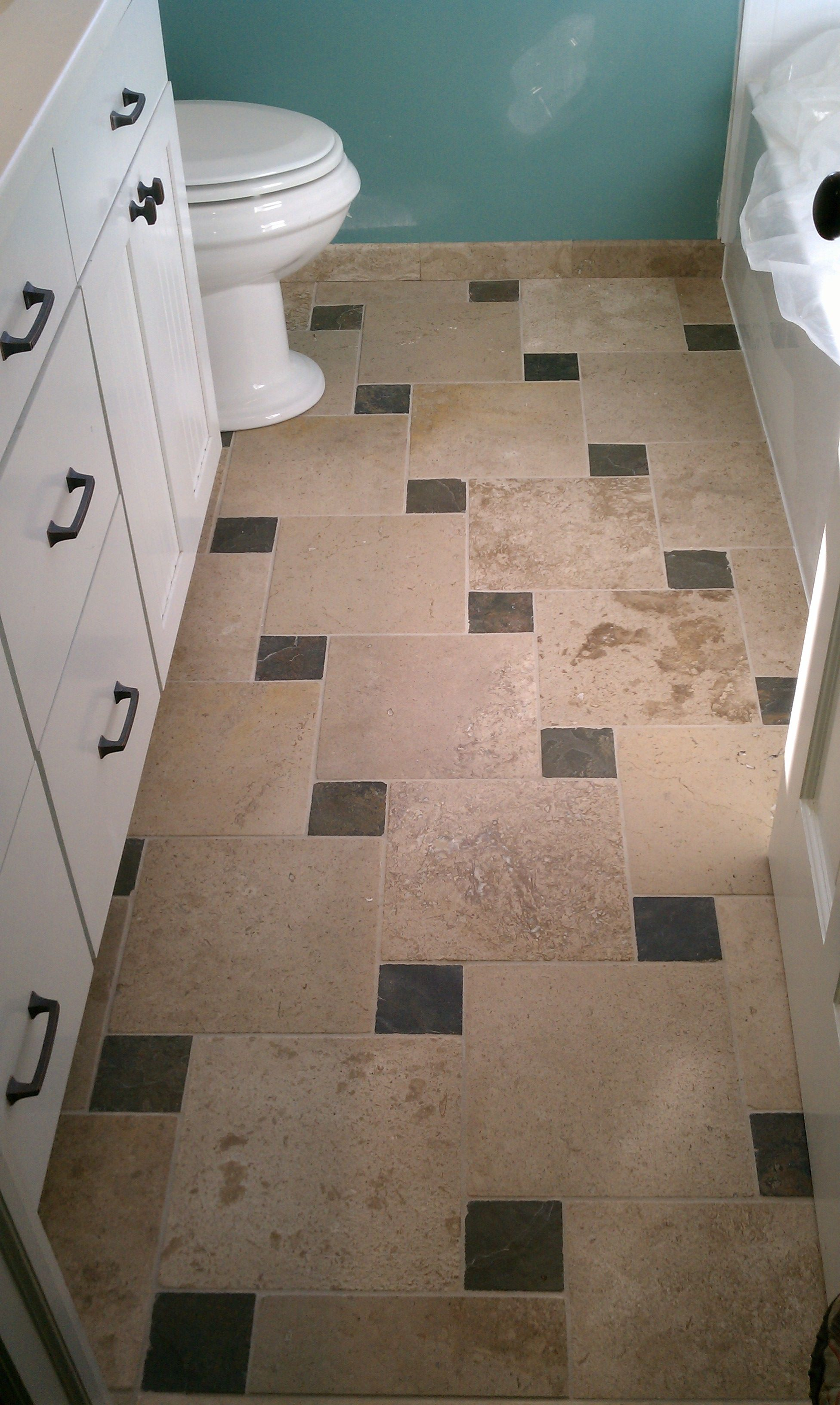Pinwheel tile pattern he who trims himself to suit everyone will pinwheel pattern with travertine and slate accents dailygadgetfo Choice Image