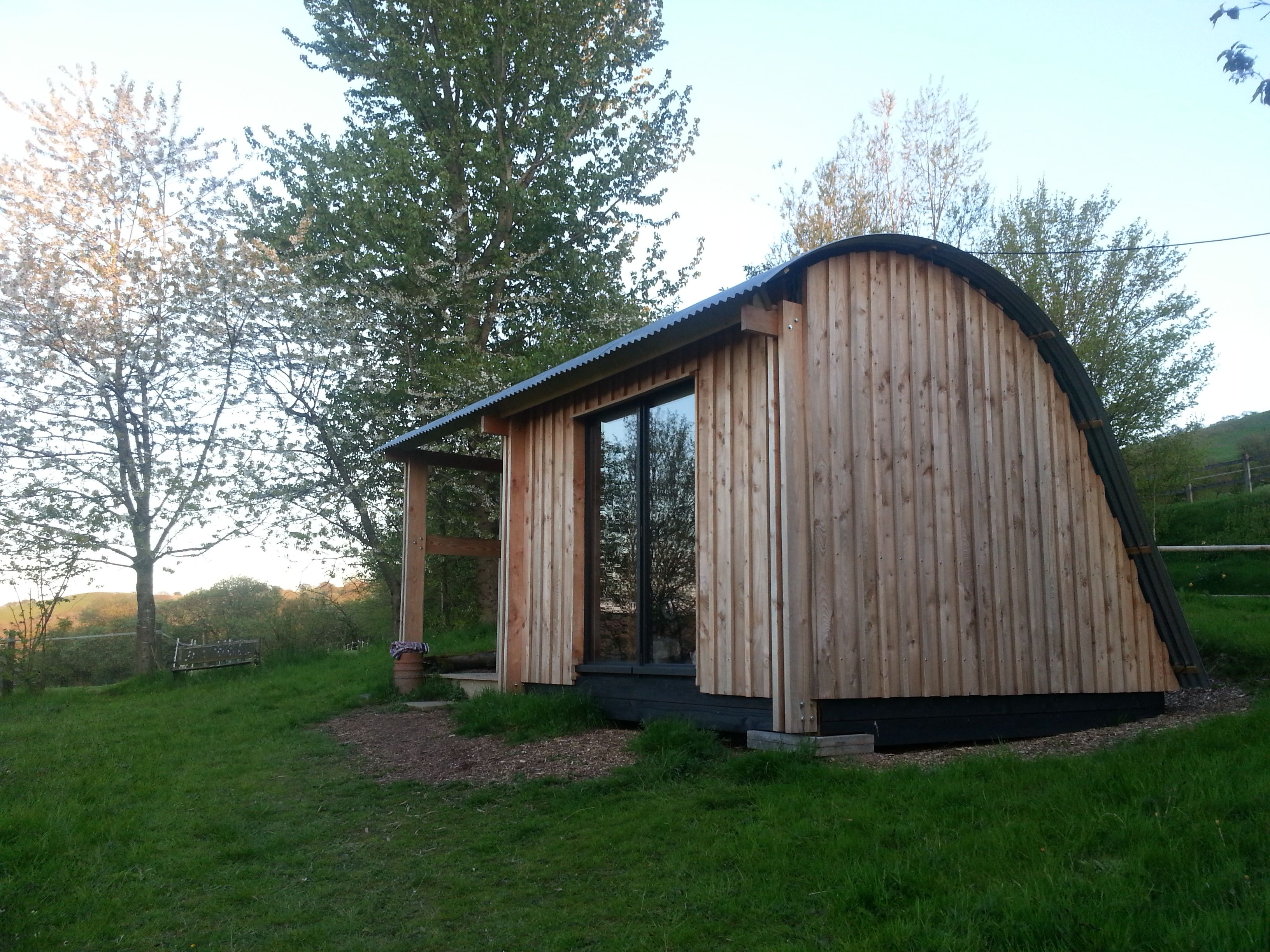 Do You Like Morphpod S Curved Roof Some People Ask About The Noise In The Rain Well Its Been Designed To Allow Camping Pod Timber Buildings Building Design
