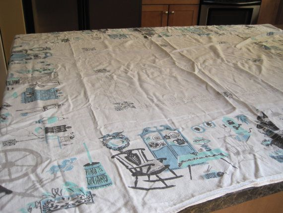Vintage MidCentury Cotton Tablecloth:  Spinning wheels and tea kettles. $22.00, via Etsy.
