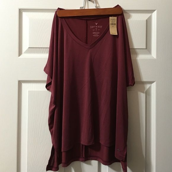 AEO Soft & Sexy T Burgundy, wine color. Super, super soft material. Features a dolman short sleeve. V-neck. Side vents. Has a slight hi-lo hem. Never worn, still has tags. Just the wrong size for me! Size large, fits like a baggy medium. American Eagle Outfitters Tops Tees - Short Sleeve