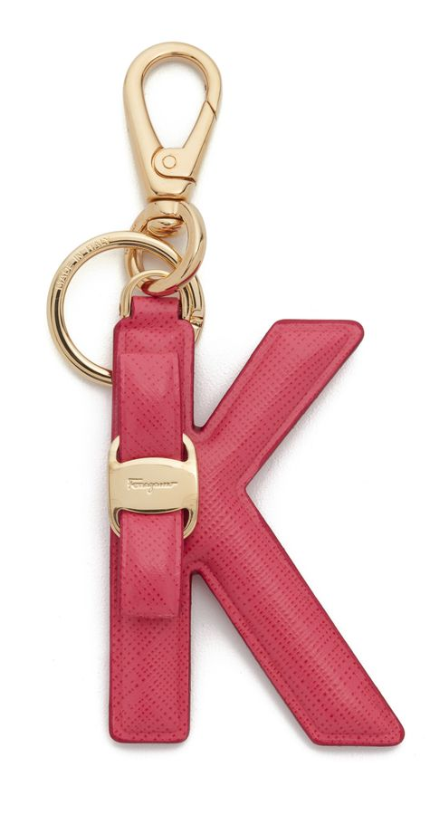 This leather Salvatore Ferragamo bag charm is detailed with a signature  bow. Spring lock and key ring at end. Made in Italy. Measurements Length   4.75in ... 3ed79043aa81d