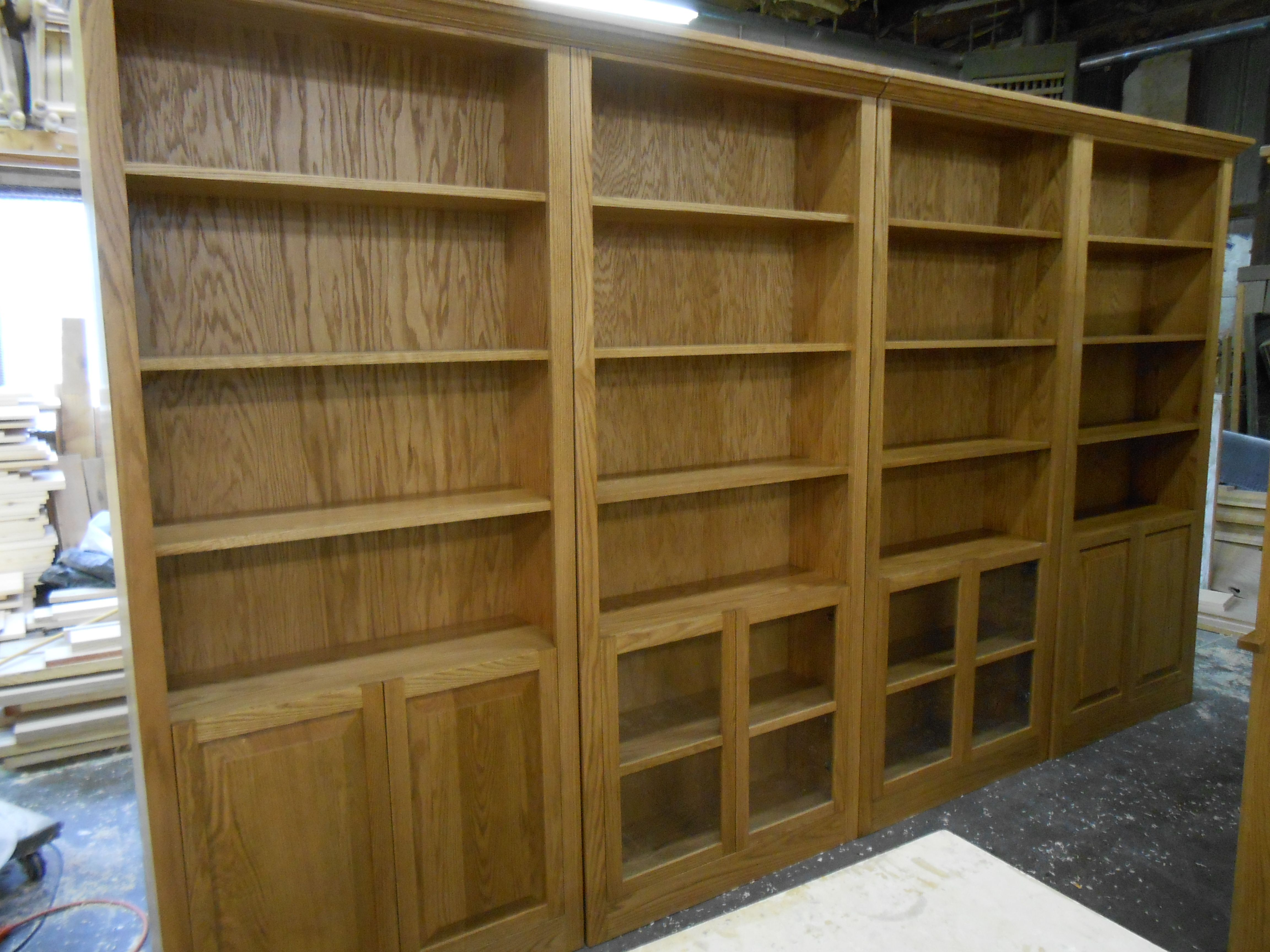 Solid oak wall of bookcases built by w harris and sons in