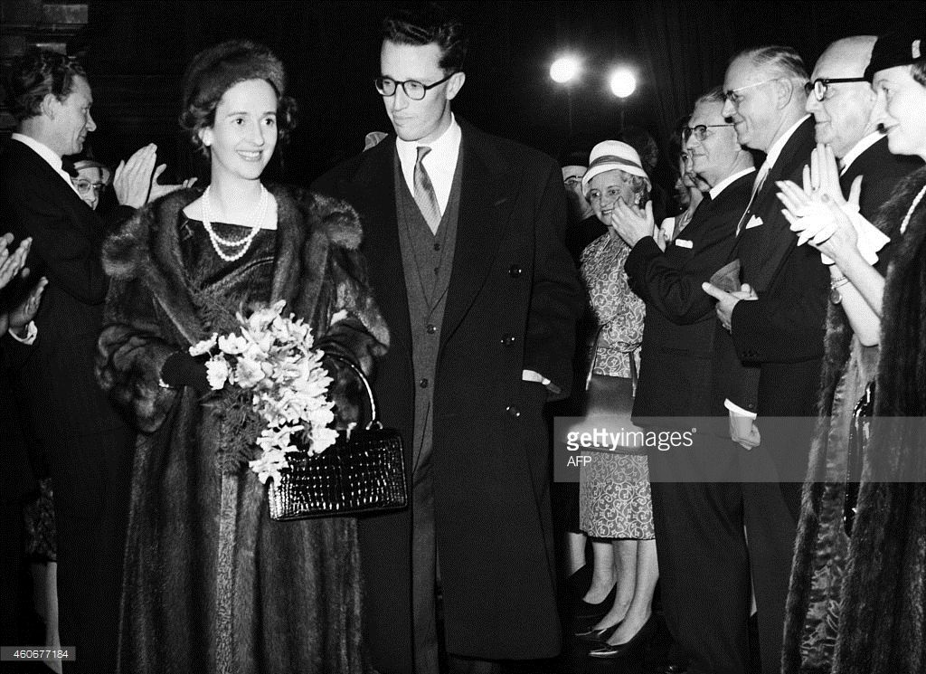 Dona Fabiola de Mora y Aragon, fiancee and futur Queen Fabiola of Belgium and Belgian King Baudouin are acclaimed by guests when entering the town hall of Antwerp, on October 22, 1960, Belgium . (Photo credit should read STRINGER/AFP/Getty Images)