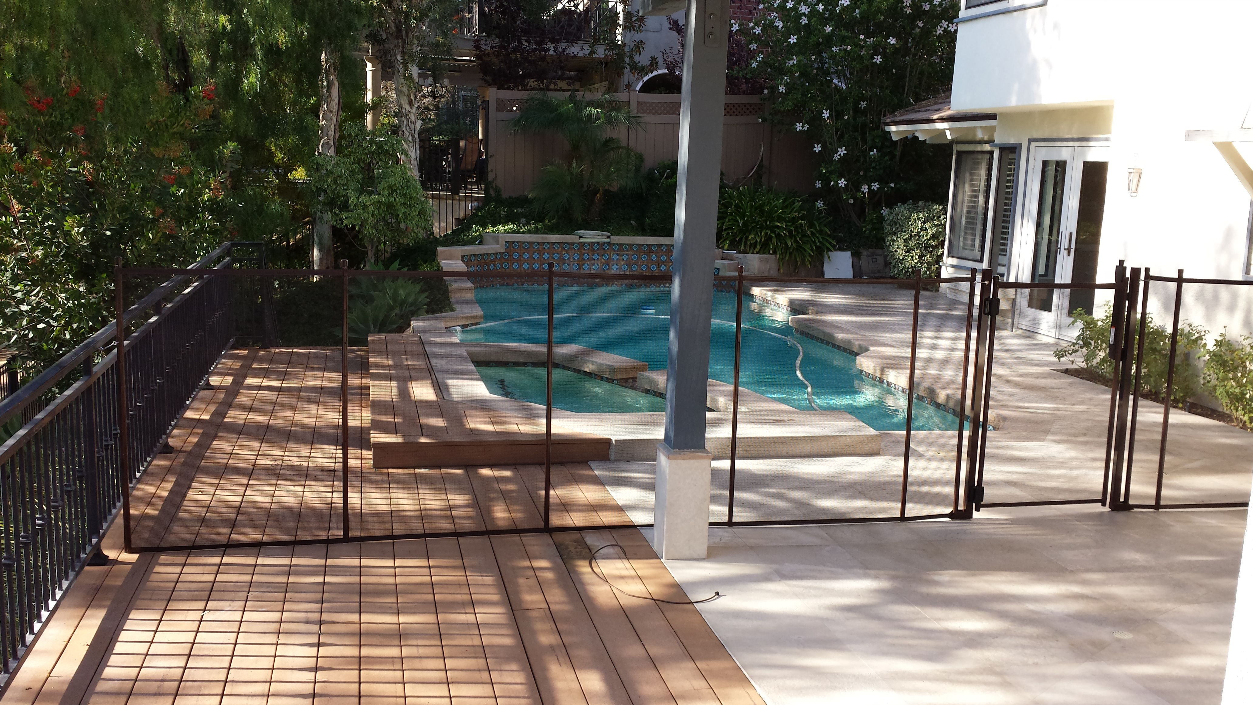 Child safety fencing installed on a wood deck removable