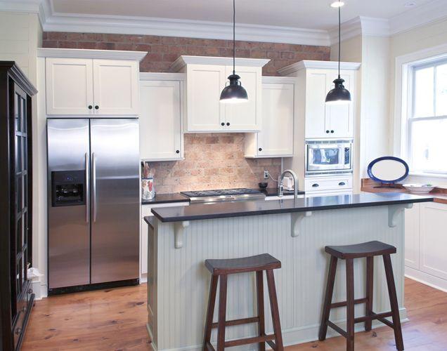 Vintage Brick Veneer accent wall and backsplash in a kitchen ...