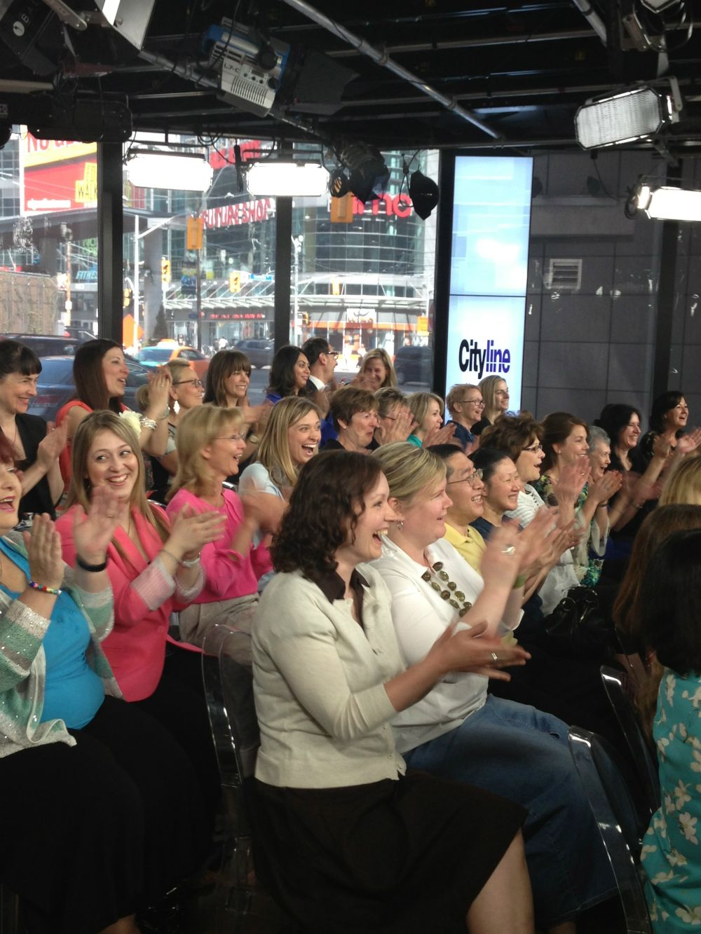 The audience goes wild after hearing they have all won a trip for two with Porter Airlines!