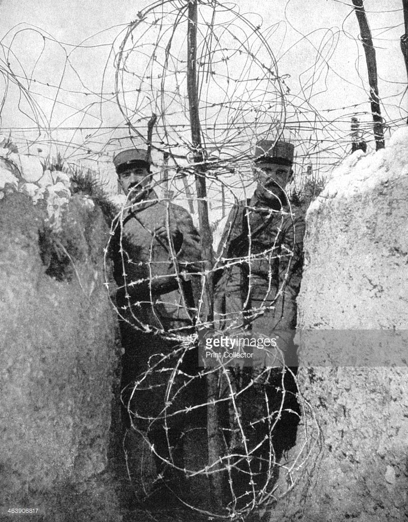 Barbed wire surrounding a French trench, World War I, 1915 ...