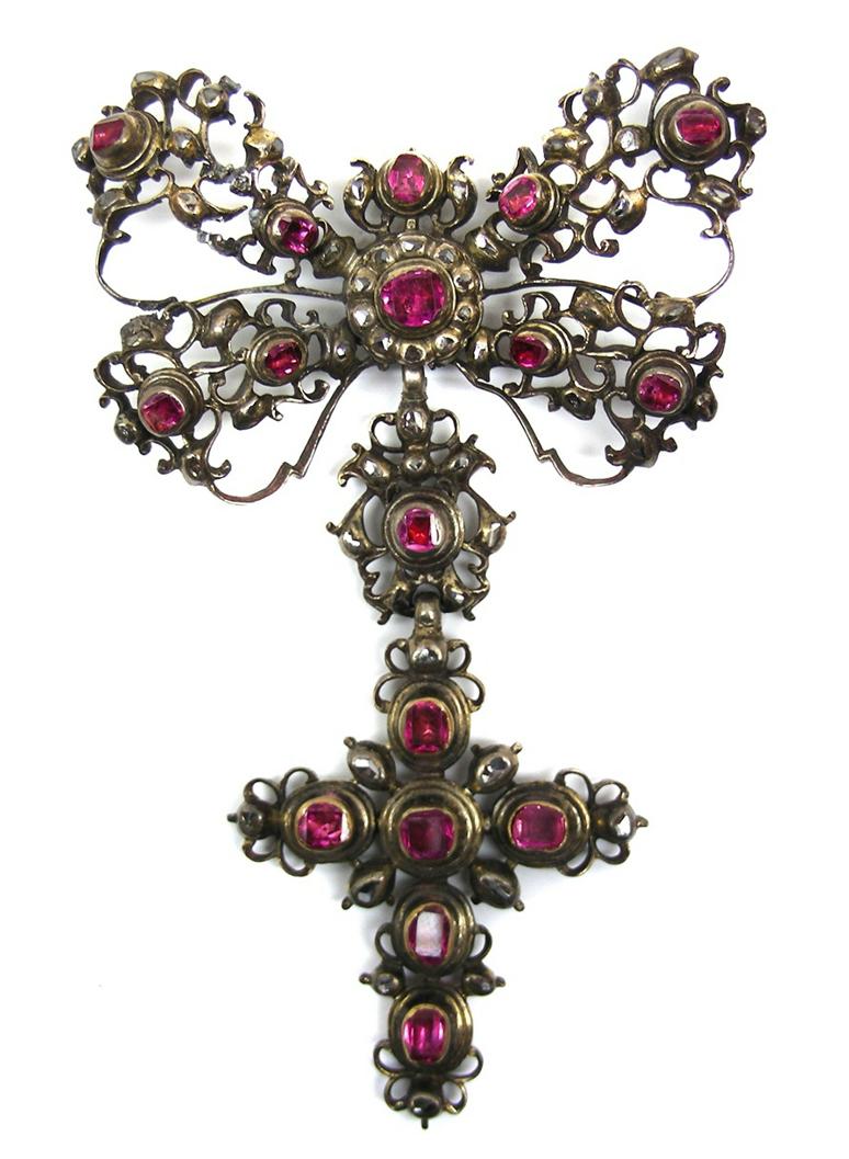 Early 18th century ruby and rose diamond cross pendant, Spanish c.1700   , the cross below a ribbon tied bow with lines of rubies to an openwork scroll frame set with rose diamonds, the bow with ruby and diamond cluster to centre, close set in silver   Length 10cms