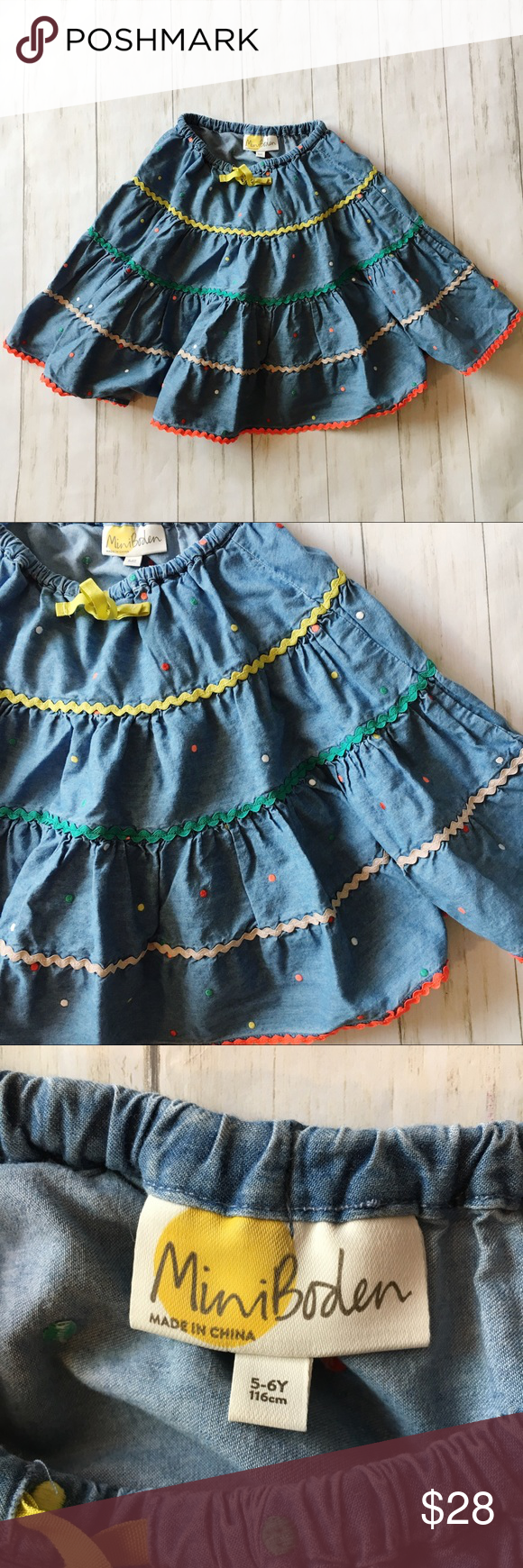 Mini Boden Chambray Embroidered Dot Twirl Skirt Mini Boden  Twirl Skirt Size 5-6 Years Blue Chambray with Multi Color Embroidered Polka Dots Multi Color Zig Zag Detail  Elastic Waistband  Drawstring  Machine wash  100% Cotton  Waist 8.5 across, length 15  Pre owned, excellent condition. No holes or stains.  |All measurements are approximate|  (0807) Mini Boden Bottoms Skirts #twirlskirt Mini Boden Chambray Embroidered Dot Twirl Skirt Mini Boden  Twirl Skirt Size 5-6 Years Blue Chambray with Mu #twirlskirt