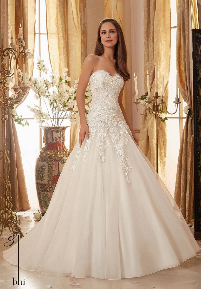 Featuring a softly scalloped sweetheart neckline, this Mori Lee Blu ...