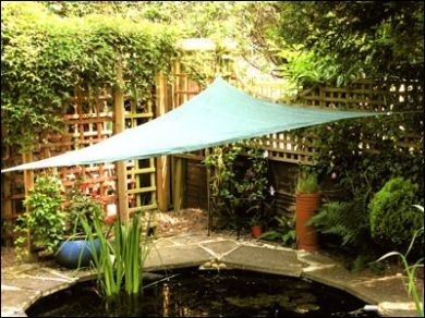 Pin by wendy on secret garden garden sail sun sail for Pond shade ideas