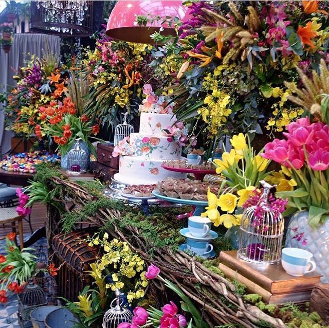What a gorgeous setting for the wedding cake for a garden or enchanted forest wedding!