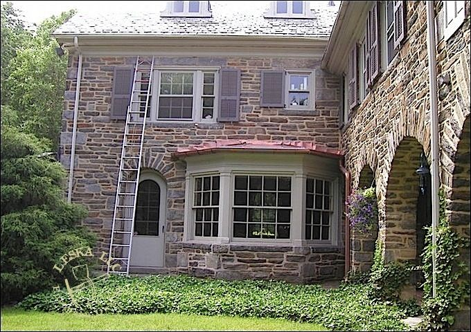 Stone Siding On Main House With Metal Roof Over Bay Window Maine