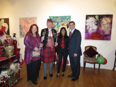 """H.R.H.-H.E. Ambassador Dr. Alton Louis Amsterdam III, International Ambassador-at-Large greeting Ms. Shandra Freeman (cr), Dr. Paul Romanello, M.D., Director of Park East Medical Center - Lenox Hill Hospital (r) and SÜ (l) at the """"Holiday Fete: 12-12-12"""" Party!"""