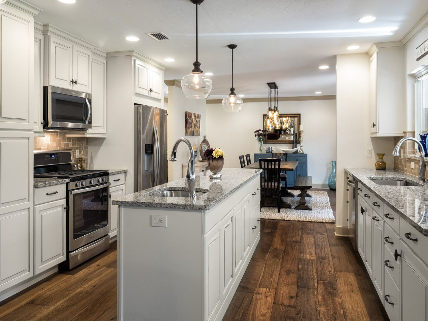 Galley Kitchen With Island Drop Pendants Wood Floors Cream Colored Cabinets Granite Counte Galley Kitchen Layout Galley Style Kitchen Galley Kitchen Design