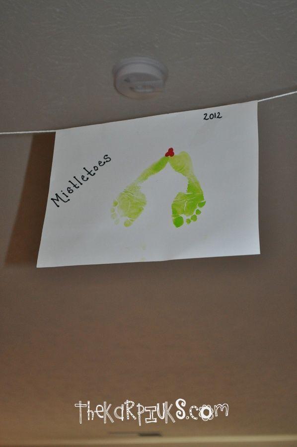 Footprint Mistletoe Craft | hanging toddler footprints like mistletoe - mistleTOES! #mistletoesfootprintcraft Footprint Mistletoe Craft | hanging toddler footprints like mistletoe - mistleTOES! #mistletoesfootprintcraft