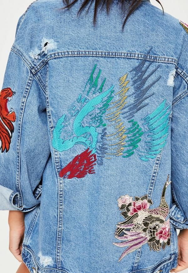 Be a decorative addict! This is classic denim with a twist - featuring embroidered detailing and an oversized fit, this destroyed denim jacket will take you from street to sleek.