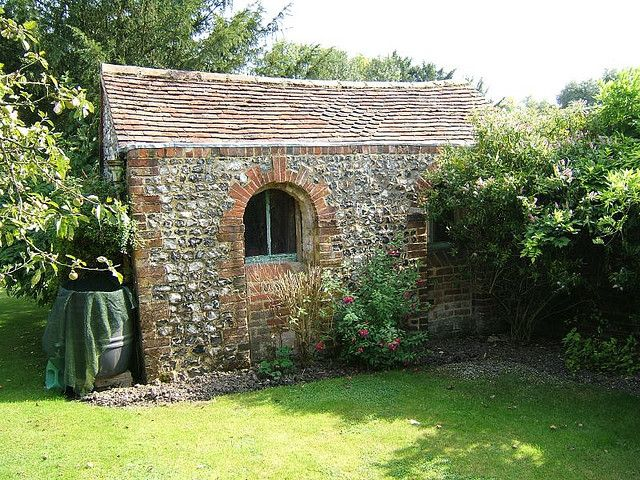 Potting shed rustic stone bricks and stone for Brick garden shed designs