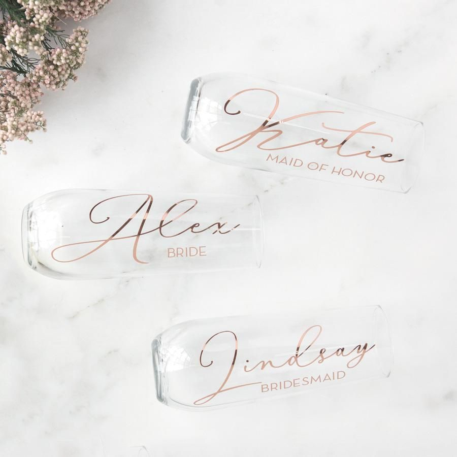 Pop the bubbly, our stemless champagne flutes are perfect bridesmaid gifts! Perfect for your bridesmaid proposals, or even for the bachelorette party or wedding day. Names and titles are printed your choice of 12 colors (Mirrored Gold pictured) in a beautiful script font. Cheers! - Personalize with any name / bridal party title and choose from 12 lettering colors - Recommended hand washing - Glass holds 8.5 oz and is approximately 6