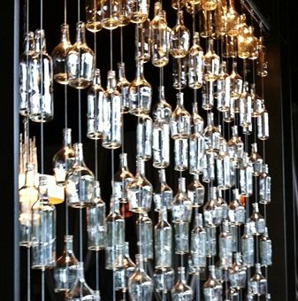 Beer Bottle Chandeliers Room divider made from clear glass bottles for the home room divider made from clear glass bottles for the home pinterest glass bottle divider and beer bottle chandelier audiocablefo