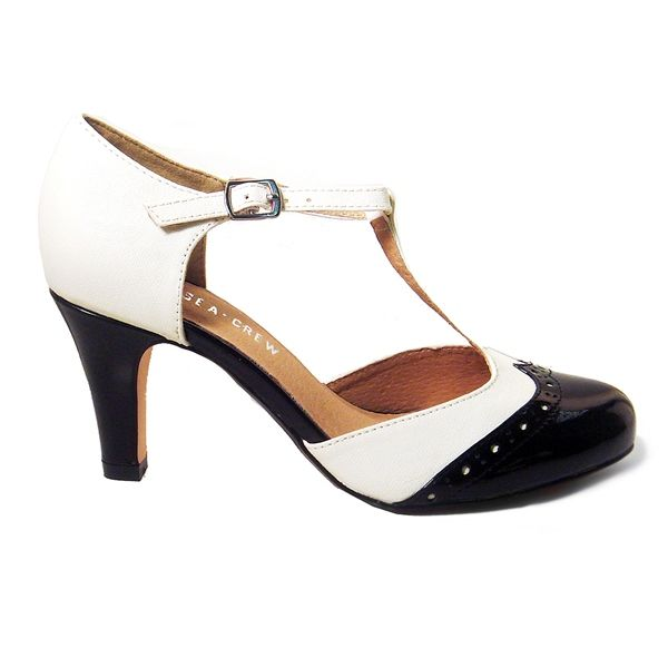 Be as lavish as an heiress flaunting Gatsby by Chelsea Crew Its a two-tone faux leather pump featuring a T-strap upper with an adjustable buckle strap and perforated wing-tip toe on a sleek patent tapered heel. A padded footbed provides comfort leather lining offers low-abrasion and man-made outsole ensures a spotlight stride.