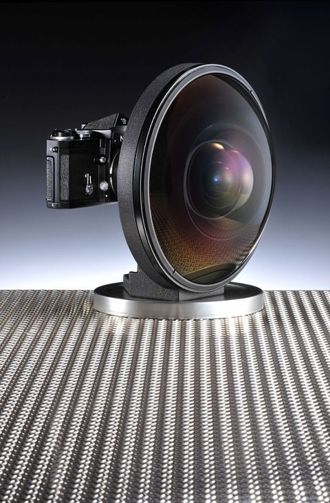 A rare £100,000 Nikon fisheye lens, said to be able to 'see behind itself' – and dwarfing any camera it is attached to – has gone on sale in London. The Fisheye-Nikkor 6mm f/2.8 was credited as the world's most extreme wideangle lens to cover the 24x36mm image area when it was unveiled at the Photokina trade show in Cologne, Germany in 1970. It weighs a whopping 5.2kg, is 171mm long and has a diameter of 236mm.