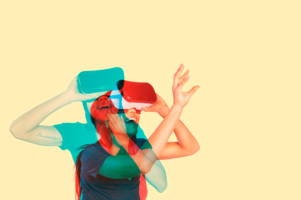 Young woman playing with virtual reality. Multiple