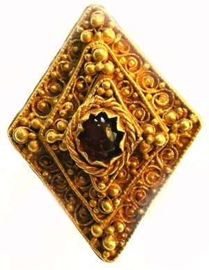 Cab0chon Ring found in Leeds, West Yorkshire - an unusually large, complete and spectacular gold ring with a lozenge-shaped bezel set with a garnet gem. Anglo-Saxon pieces of such high quality are extremely rare. It was made to be displayed as a sign of great wealth and status and is in near perfect condition.