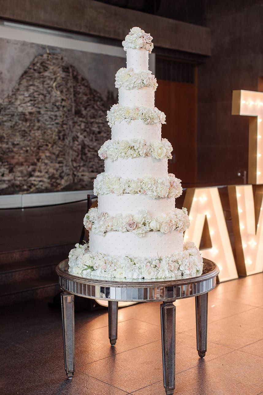 Grand 6 Tier Luxe White Wedding Cake From Creme De La Creme Photo By Sara Kate Photography Wedding Cakes With Flowers Luxury Wedding Cake Wedding Cake Table
