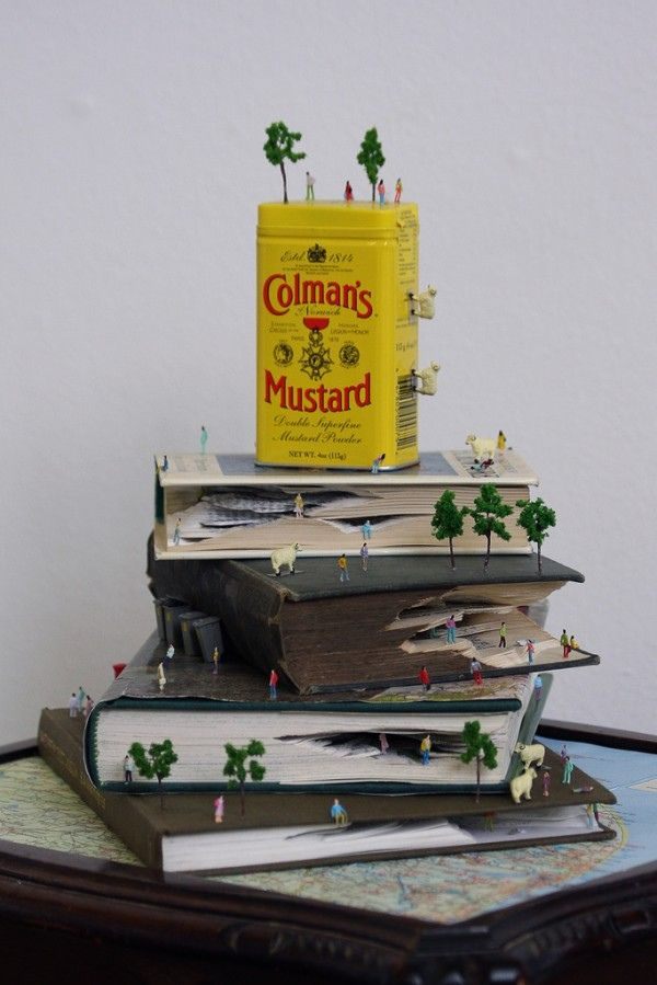 Kyle Kirkpatrick makes tiny landscapes from carved books.