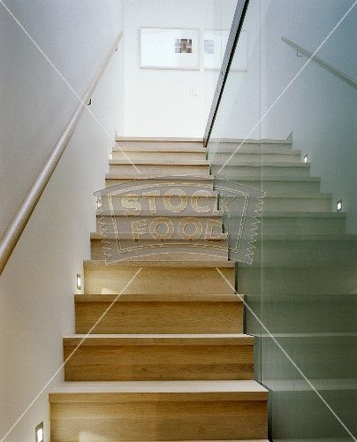 Best A Narrow Stairway With Wooden Steps And A Glass Partition 400 x 300