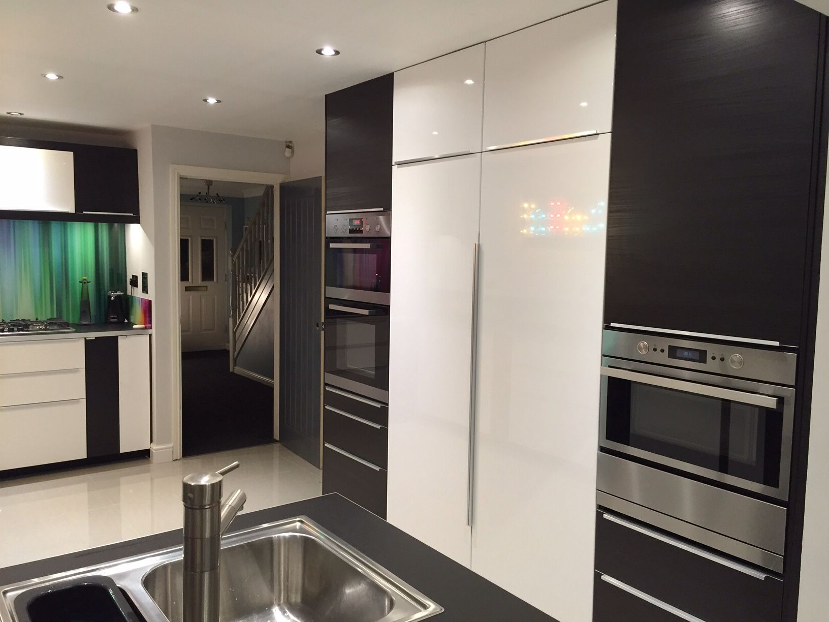 Ikea Ringhult High Gloss White And Tingsryd Black Kitchen With Appliance Wall Incorporating Ful Kitchen Decor Modern Kitchen Remodel Design Double Oven Kitchen