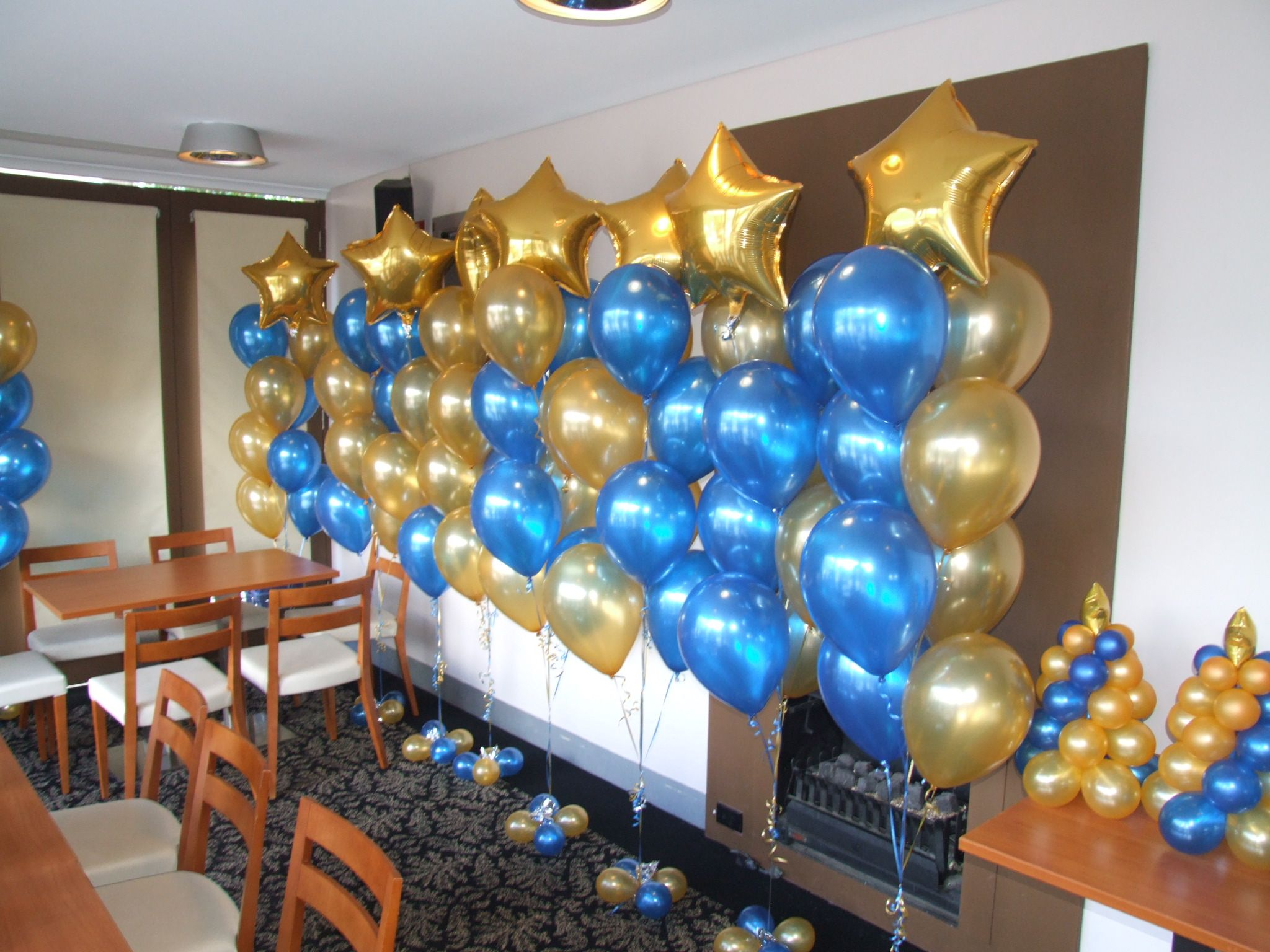 Sapphire blue and gold floor arrangements all with