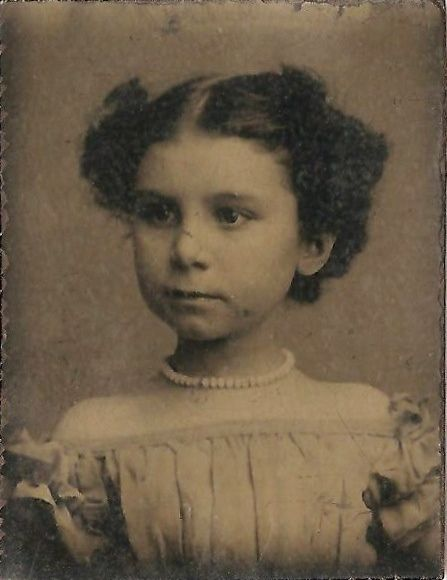 Tintype of an adorable little girl - I get a mid to late 1860s vibe off of this.