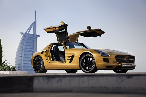 The Desert Gold Mercedes Benz Sls Amg In Front Of The Burj Al