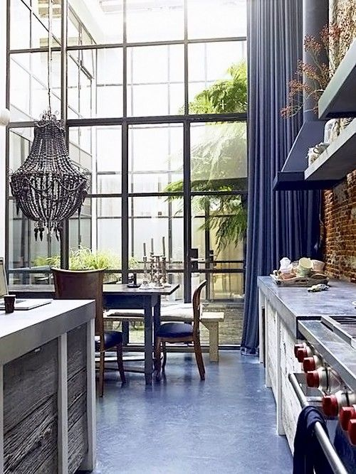 Suzie Kitchen With High Ceiling Exposed Brick Walls