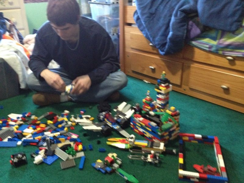 This is me playing with Legos, my favorite childhood activity. I make all kinds of creations from my imagination.
