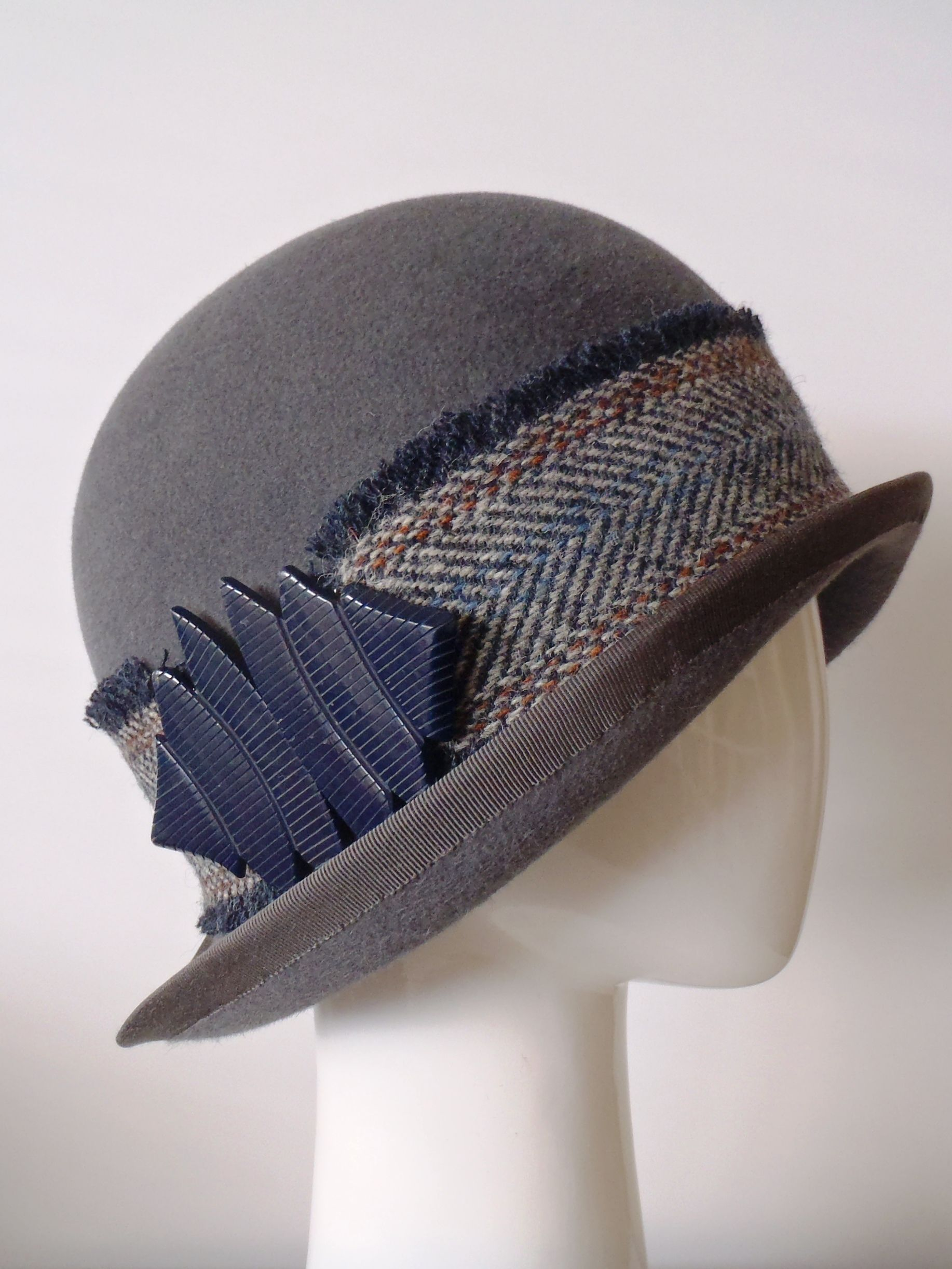 c8f361cf985 Pewter grey velour felt cloche hat with upturned brim and Harris Tweed  band. Vintage Bakelite buckle on RHS.