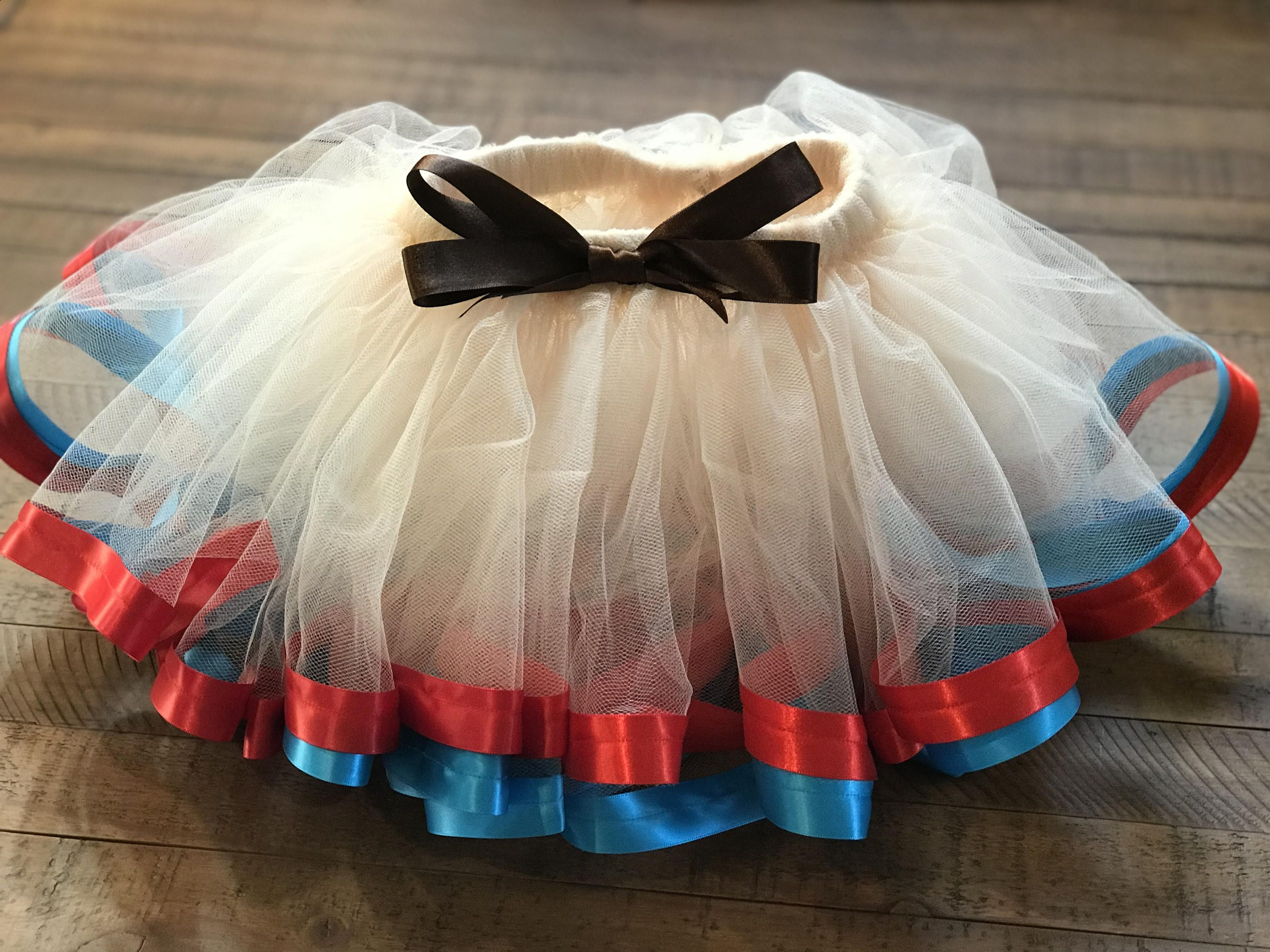 ee9e26ae4 Princess Moana Inspired Tutu/ Beige tulle tutu/teal and red ribbon/ brown  front bow by NandLTutus on Etsy