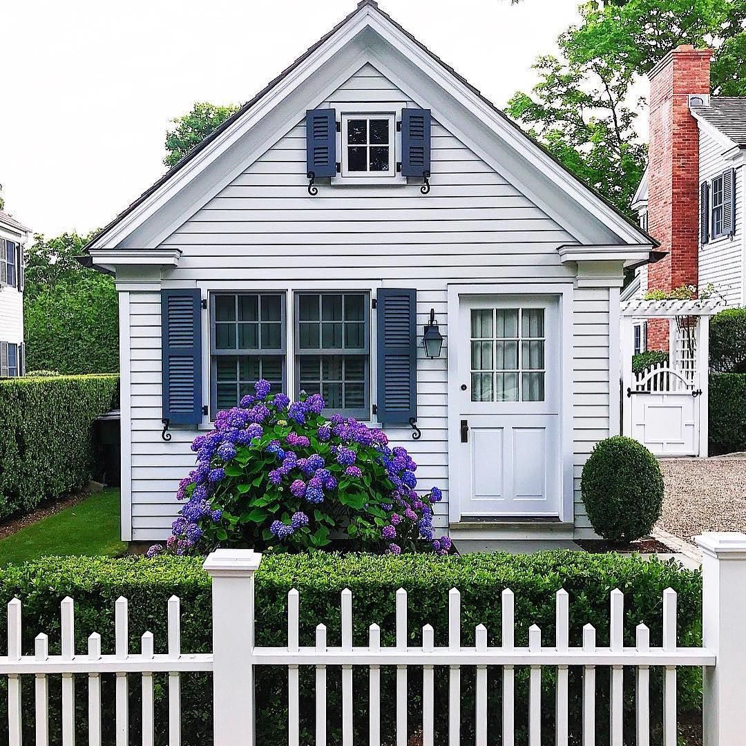 The hydrangeas make the perfect addition to this cozy little cottage
