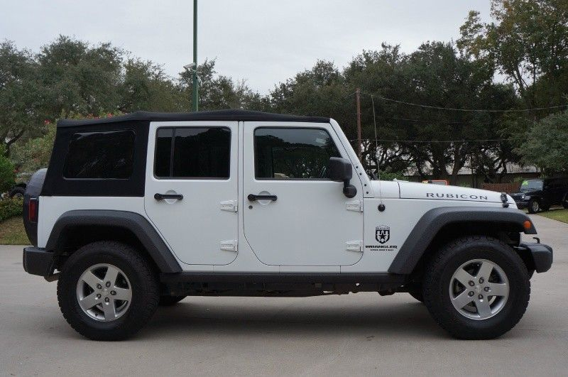 2011 White Rubicon Unlimited Jeep Wrangler Premium Soft Top Leather W Heated Seats Side A Jeep Wrangler Soft Top Jeep Wrangler Unlimited 2011 Jeep Wrangler