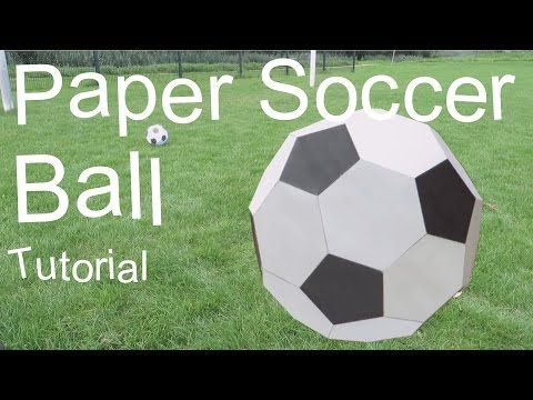 Hand Spinning Paper Soccer Ball On Green Background Origami Paper ... | 360x480