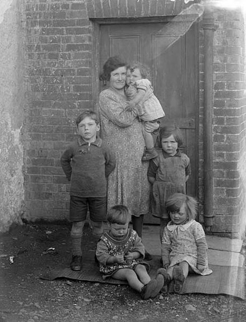 This is Mrs Flynn with her children. Photo taken at Leperstown, near Dunmore East, Co. Waterford.  Date: 21 September 1933  NLI Ref.: P_WP_4003