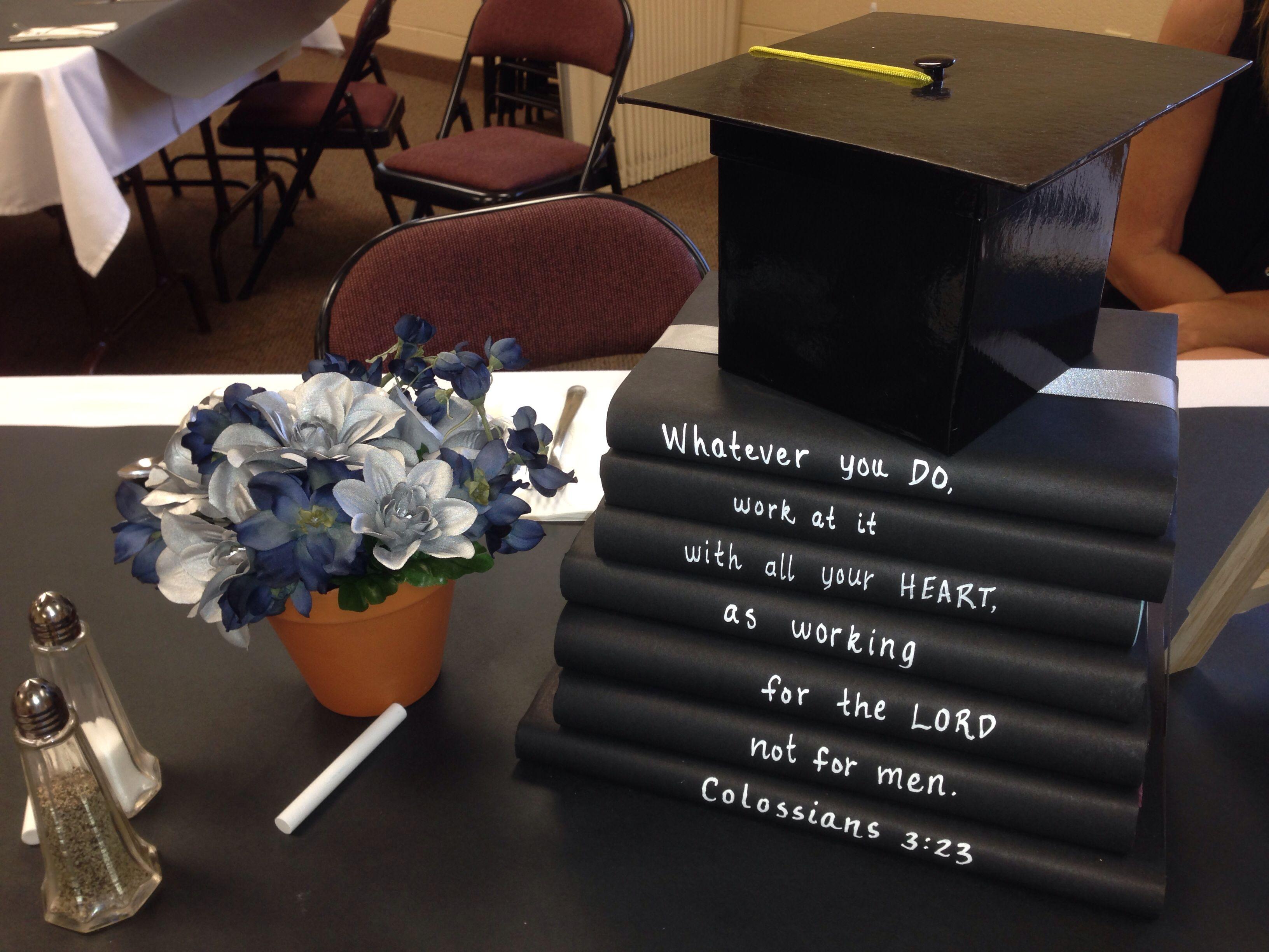 Graduation centerpiece use black butcher paper as a