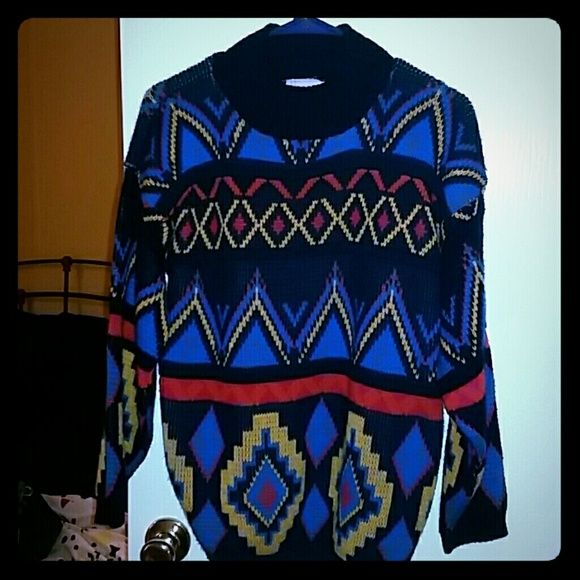Colorful  Sweater. Comfy sweater. Gently worn. I would say a medium. I wore  with leggings or ripped up jeans. Sweaters Crew & Scoop Necks