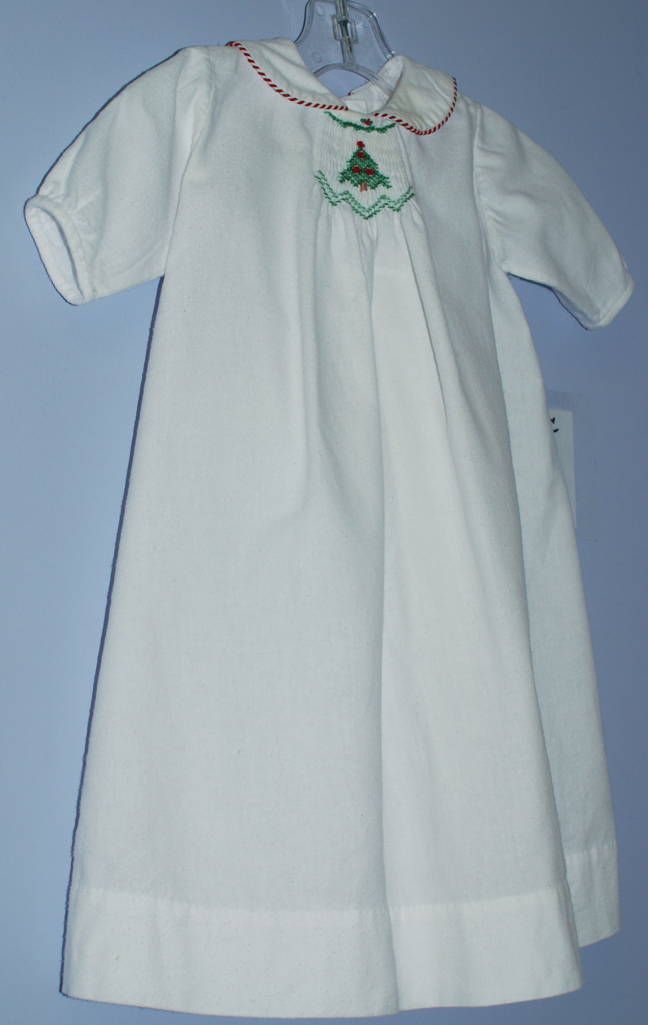 Center smocked Christmas tree on day gown. Childrens